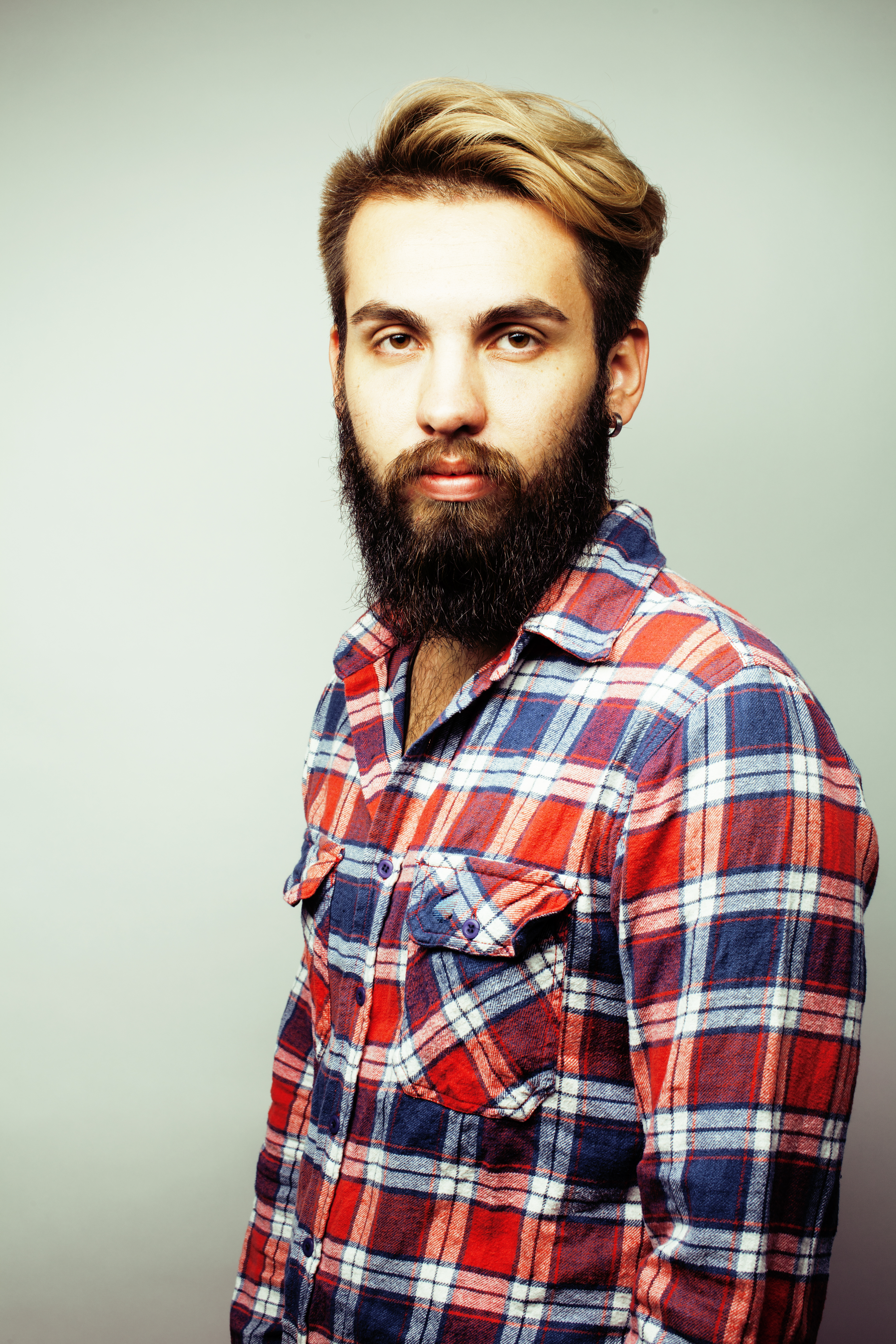 cb486b42 portrait of young bearded hipster guy smiling on white background close up,  brutal man, lifestyle people concept